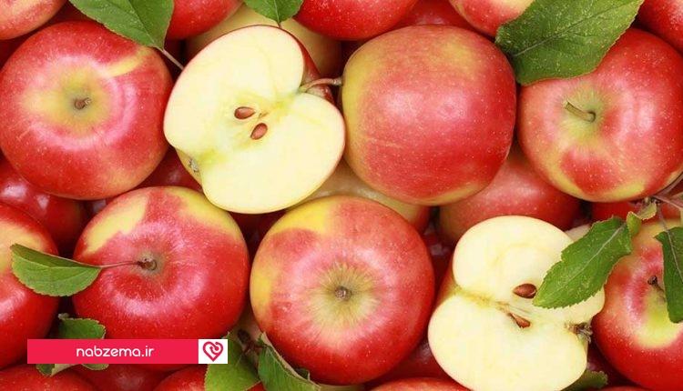 عکس سیب کامل و سیب نصفه